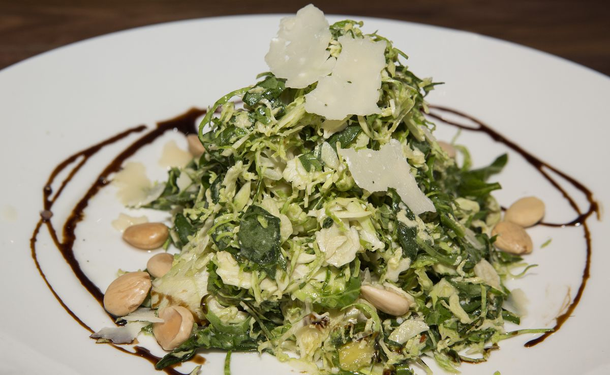 Shaved Brussels sprouts on a white plate