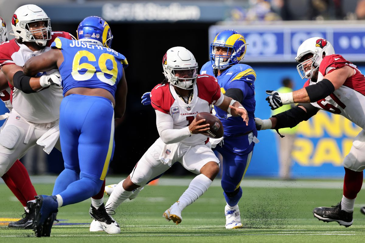 Quarterback Kyler Murray #1 of the Arizona Cardinals is chased out of the pocket by Aaron Donald #99 of the Los Angeles Rams in the third quarter at SoFi Stadium on October 03, 2021 in Inglewood, California.