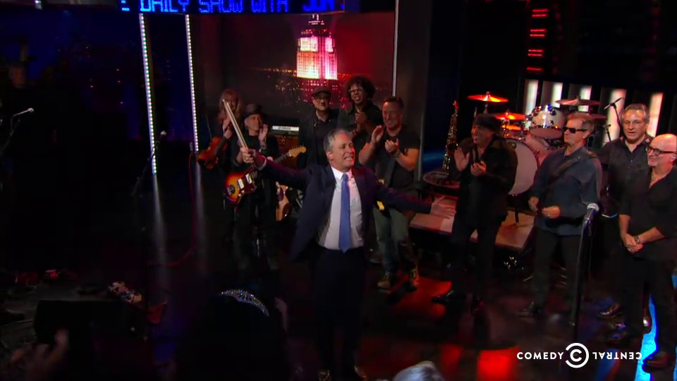 Jon Stewart appears before Bruce Springsteen and the E-Street Band on the last Daily Show.