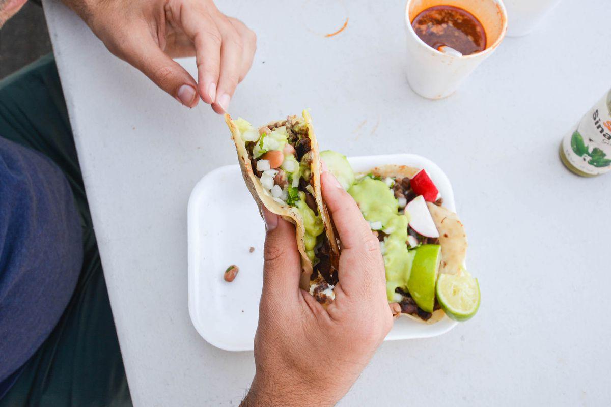 el ruso taco being eaten over table