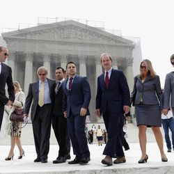 From second from left: Attorney Ted Olson; Proposition 8 plaintiffs Jeffrey Zarrillo and Paul Katami; attorney David Boies, co-lead counsel of the legal team challenging California's same-sex marriage ban; and plaintiffs Sandy Stier and Kris Perry walk out of the Supreme Court in Washington, Monday, June 24, 2013. The Supreme Court has 11 cases, including the term's highest profile matters, to resolve before the justices take off for summer vacations, teaching assignments and international travel. (AP Photo/Charles Dharapak)