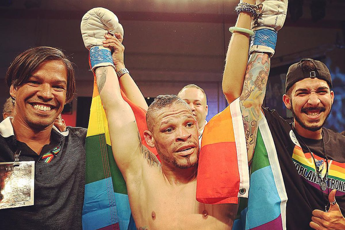 Cruz after the fight with Pedro Julio Serrano, left, and Norman Casiano, a survivor of the Pulse shooting.