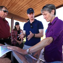 Dave Ure, executive director of the Utah School and Institutional Trust Lands Administration, listens as Fred Ferguson, chief of staff to Rep. Jason Chaffetz, R-Utah, talks with Interior Secretary Sally Jewell at Dead Horse Point in southern Utah on Thursday, July 14, 2016. During her trip to the region, Jewell said she was shocked by the lack of protection for Native American cultural sites. Today, President Barack Obama declared the Bears Ears National Monument in southeast Utah.