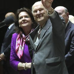 President Russell M. Nelson of The Church of Jesus Christ of Latter-day Saints and his wife Sister Wendy Nelson wave to attendees during a devotional at Movistar Arena in Bogota, Colombia, on Sunday, Aug. 25, 2019.