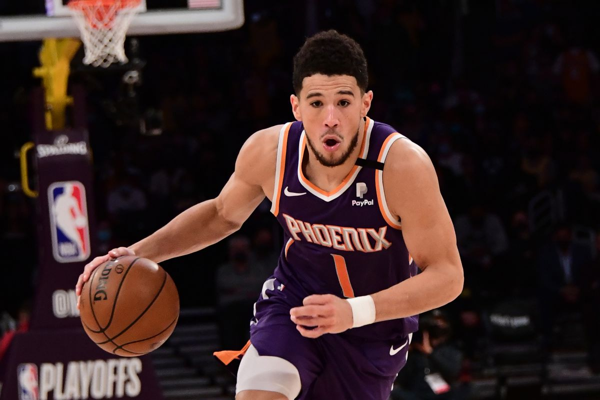 Devin Booker of the Phoenix Suns drives to the basket against the Los Angeles Lakers during Round 1, Game 6 of the 2021 NBA Playoffs on June 3, 2021 at STAPLES Center in Los Angeles, California.
