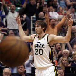 Gordon Hayward of the Utah Jazz celebrates after banking in a shot at the end of the first quarter during NBA basketball in Salt Lake City, Friday, April 12, 2013.