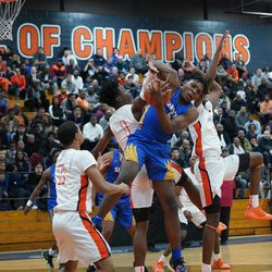 Simeon's Sincere Callwood (4) wraps up a rebound against Young. Wednesday 02-13-19. Worsom Robinson/For the Sun-Times.