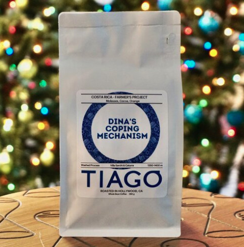 """Tiago Coffee Bar + Kitchen in Hollywood's custom coffee bag that says """"Dina's Coping Mechanism"""""""