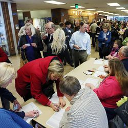Voters check in before a Utah Republican caucus at Brighton High School in Salt Lake City on Tuesday, March 22, 2016.