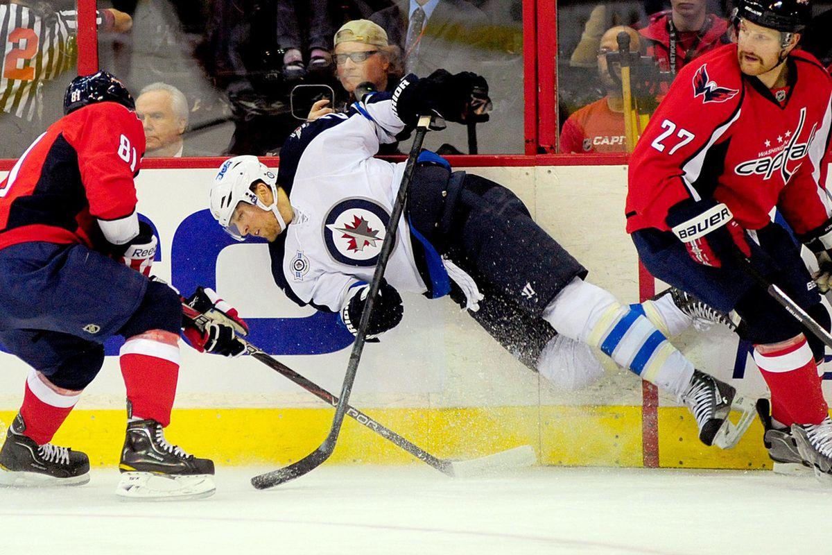 November 23, 2011;Washington D.C., USA; Winnipeg Jets right wing Blake Wheeler (29) gets knocked down by Washington Capitals defenseman Karl Alzner (27) and defenseman Dmitry Orlov (81) at Verizon Center. Mandatory Credit: Evan Habeeb-US PRESSWIRE