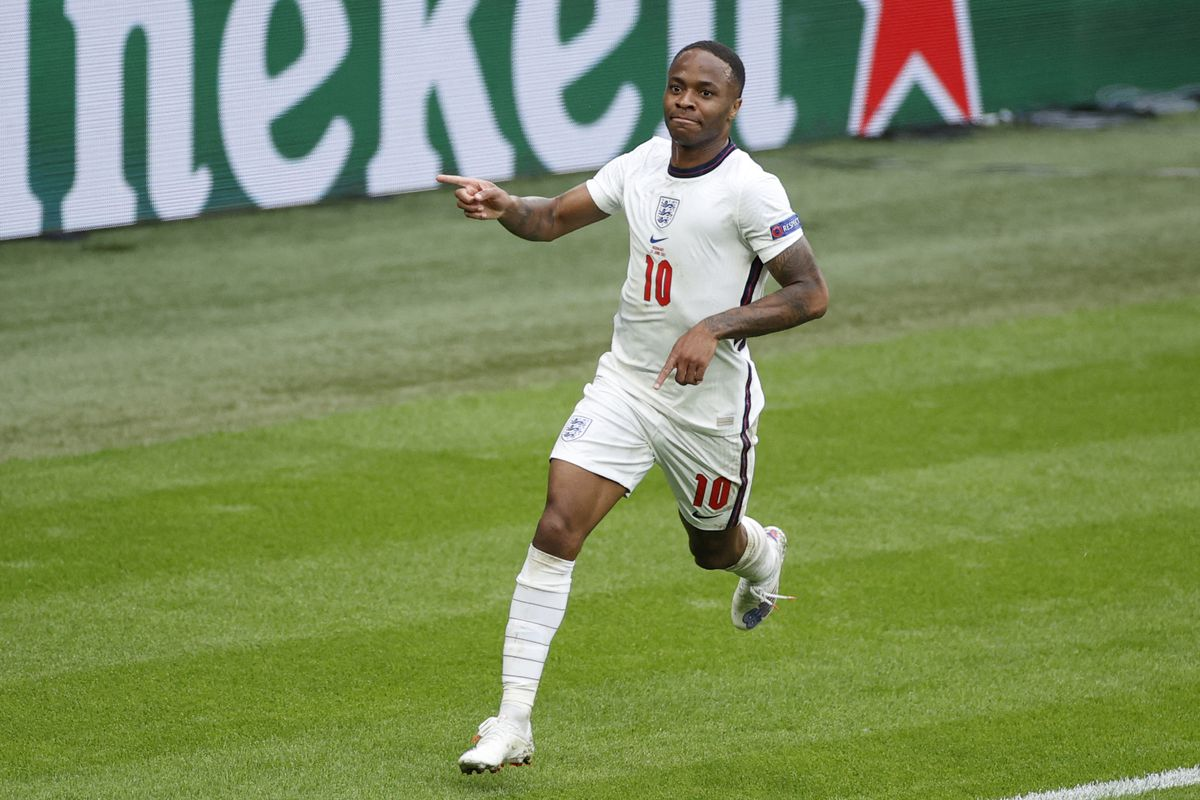 England's forward Raheem Sterling celebrates after scoring the first goal during the UEFA EURO 2020 round of 16 football match between England and Germany at Wembley Stadium in London on June 29, 2021.