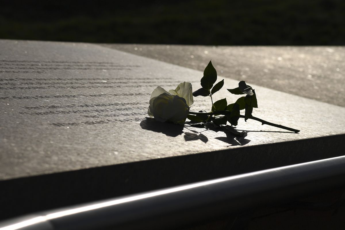 LITTLETON CO - APRIL 17: A flower is left at the Columbine Memorial on April 17, 2019 in Littleton, Colorado. Districts across the Denver metro were then closed schools as the FBI and local police searched for 18-year-old Sol Pais, a woman from Florida suspected of making threats.