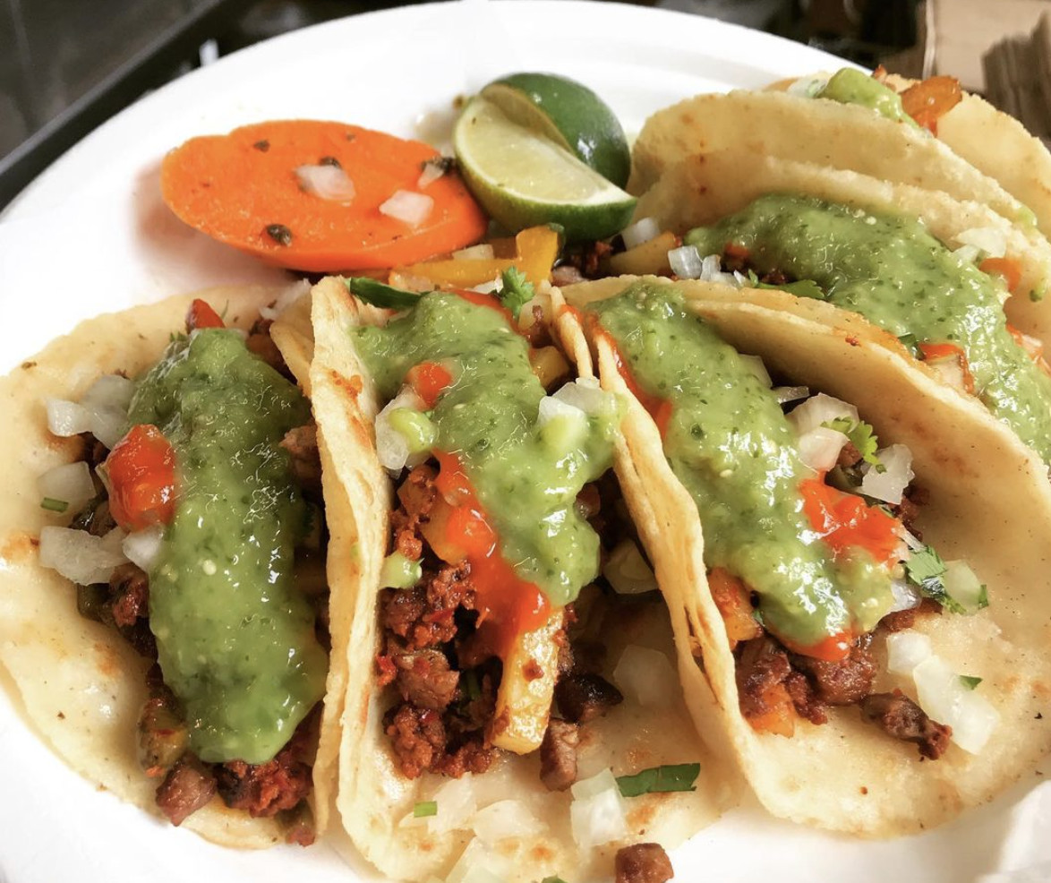 A plate displaying campechano tacos on a counter at Carmelo's