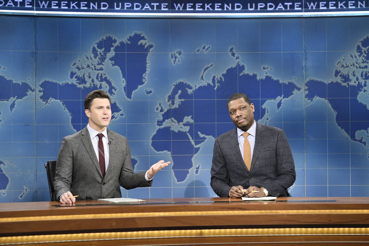 """This 2020 photo released by NBC shows Colin Jost, left, and Michael Che during the Weekend Update sketch on """"Saturday Night Live"""" in New York."""