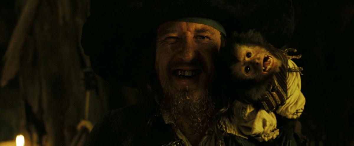 Jack the monkey sits on Barbossa's (Geoffrey Rush) shoulder