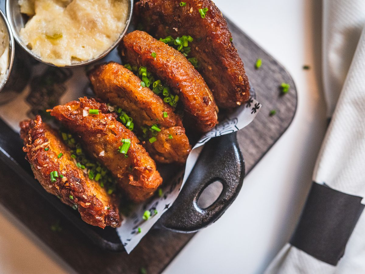 Fried potato latkes at Buffalo & Bergen come with creme fraiche and mascarpone dip and bourbon and Granny Smith apple relish.