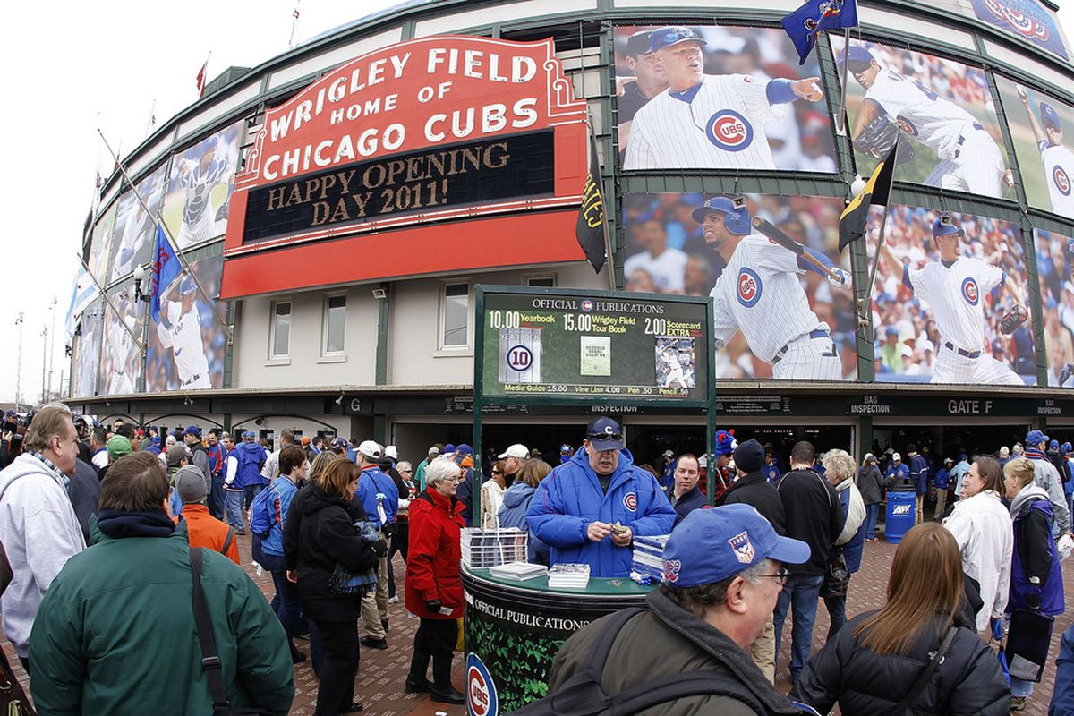 Fans head to the stadium prior to the Chicago Cubs playing the Pittsburgh Pirates on opening day at Wrigley Field on April 1, 2011 in Chicago, Illinois.  (Photo by Gregory Shamus/Getty Images)