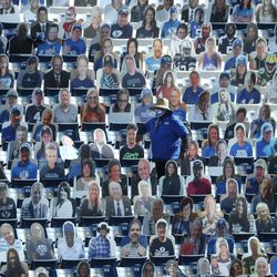 Family and friends of BYU players sit among cutout fans in a nearly empty LaVell Edwards Stadium before the Cougars game against North Alabama in Provo on Saturday, Nov. 21, 2020.