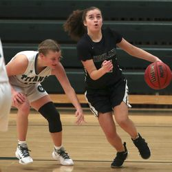 Action in the Highland at Olympus girls basketball game in Holladay on Tuesday, Jan. 5, 2021.