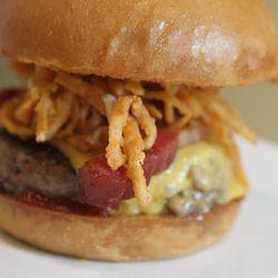 Manly Burger, beer-cheddar, bacon lardons, onion rings, ketchup and mustard