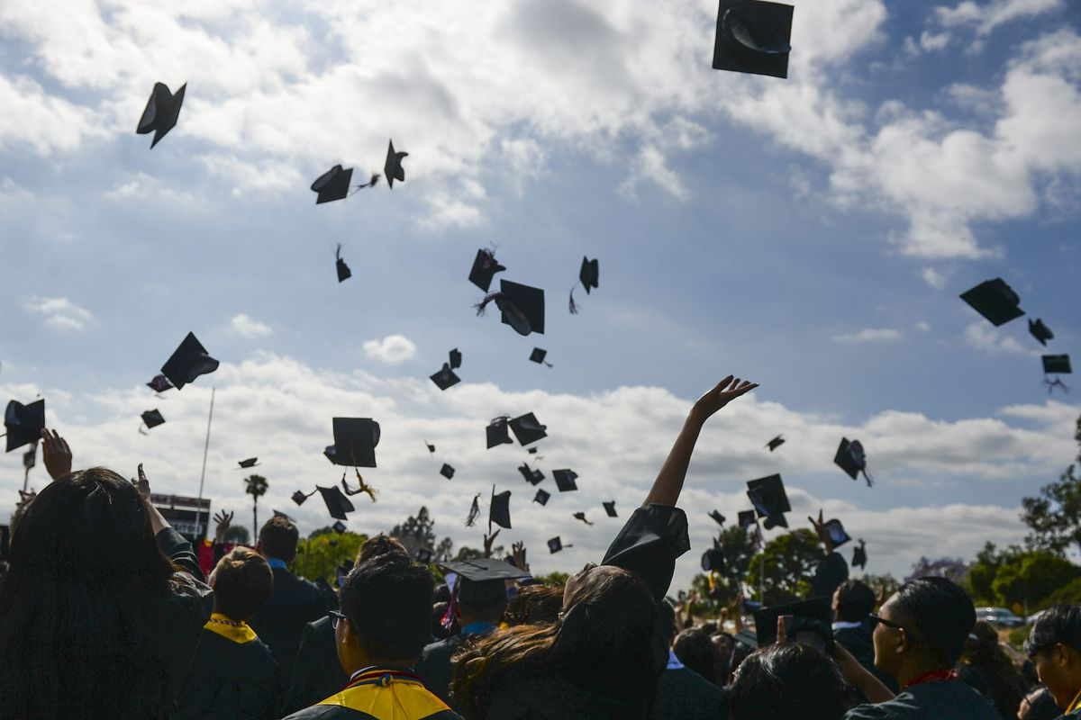Graduates toss their caps in Fullerton, California. (Photo by Kevin Sullivan/Digital First Media/Orange County Register via Getty Images)