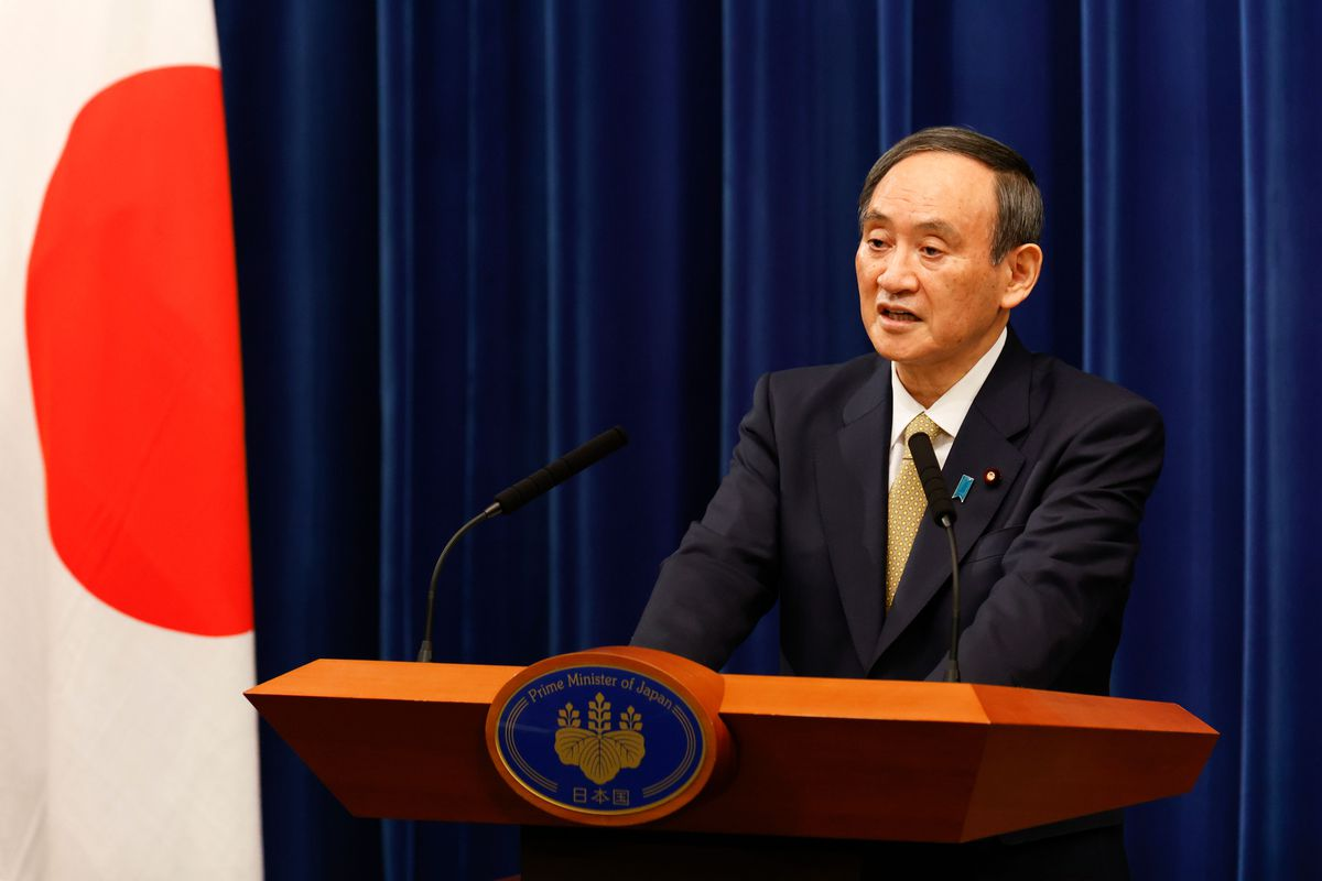 Japan's Prime Minister Yoshihide Suga speaks during a press conference at the his official residence in Tokyo on January 13, 2021 stating that 11 of the country's 47 prefectures will be under the state of emergency.
