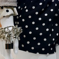 A Moschino bracelet and shorts in the regular window