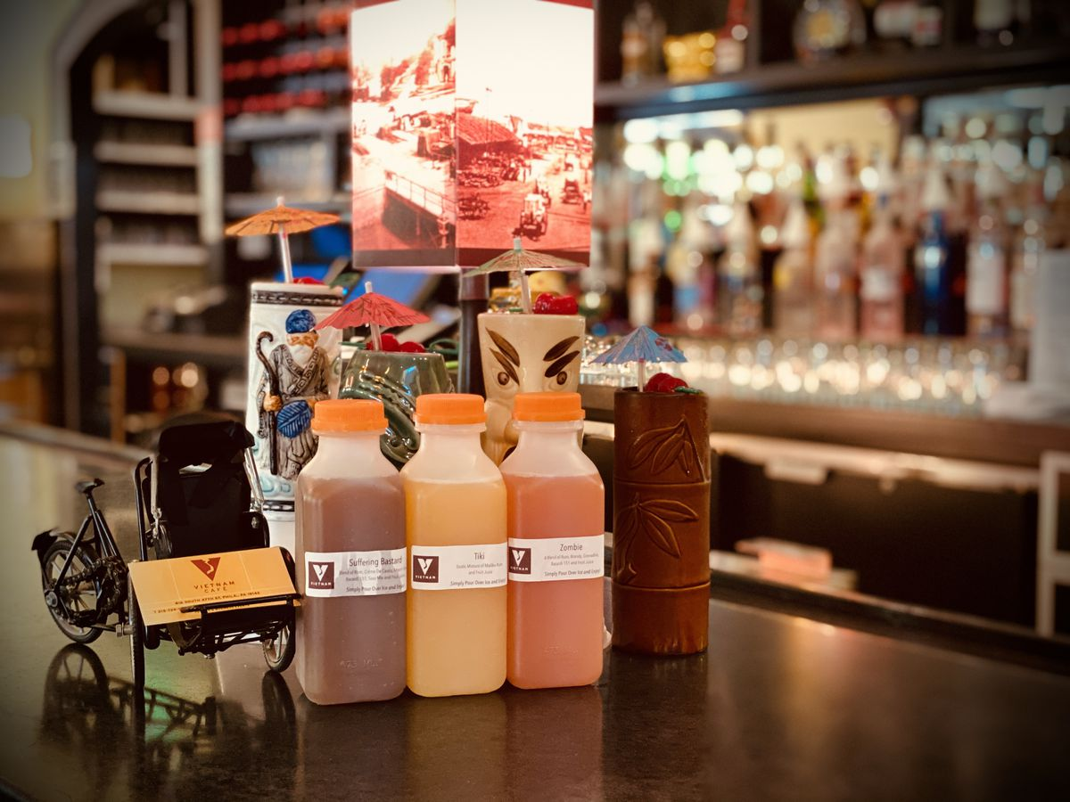 row of juice containers with labels on a bar