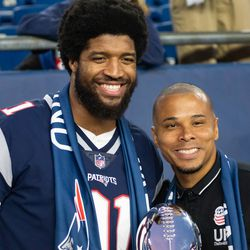 FOXBOROUGH, MA - APRIL 13: New England Patriots defensive end Deatrich Wise, Jr. and Charlie Davies with the Vince Lombardi trophy before kickoff at Gillette Stadium on April 13, 2019 in Foxborough, Massachusetts. (Photo by J. Alexander Dolan - The Bent Musket)