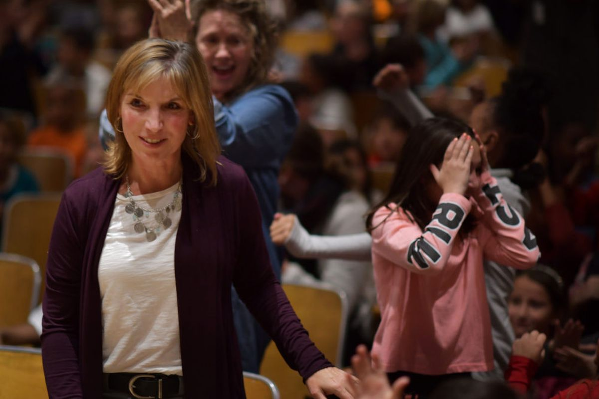 """Margaret """"Meg"""" Cypress, a fifth-grade teacher at Bradley International School in Denver, learns she is the 2019 Colorado Teacher of the Year at a school assembly Tuesday."""