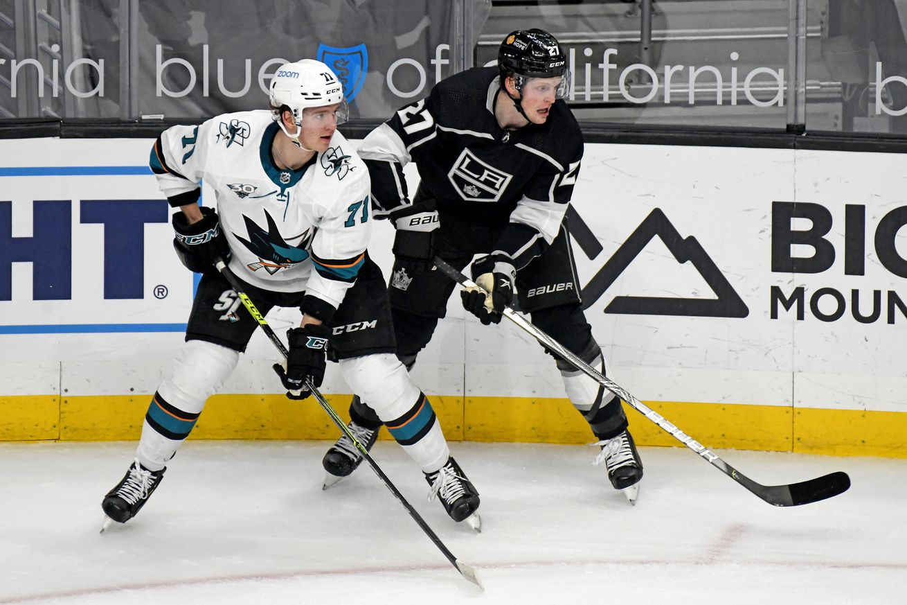 San Jose Sharks Defenceman Nikolai Knyzhov (71) and Los Angeles Kings Right Wing Austin Wagner (27) watch play during an NHL game on April 02, 2021, at the Staples Center in Los Angeles, CA.