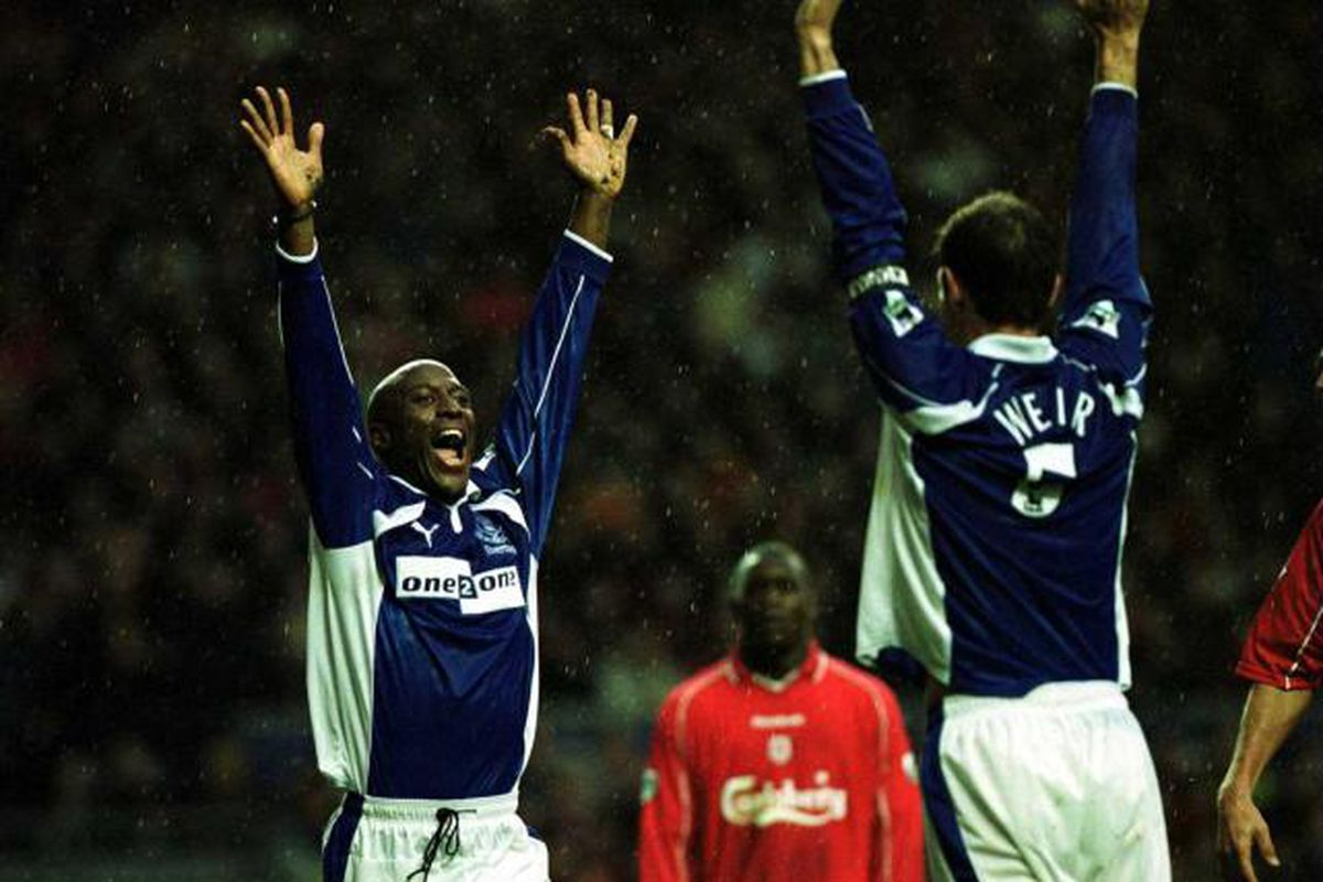 Kevin Campbell celebrates scoring at Anfield with David Weir