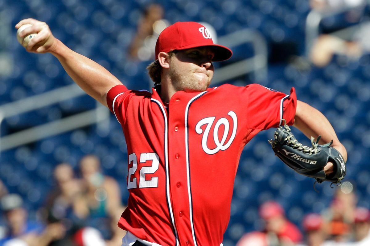 WASHINGTON, DC - JULY 31: Relief pitcher Drew Storen #22 of the Washington Nationals throws to a New York Mets batter during the ninth inning of their 3-2 win at Nationals Park on July 31, 2011 in Washington, DC.  (Photo by Rob Carr/Getty Images)