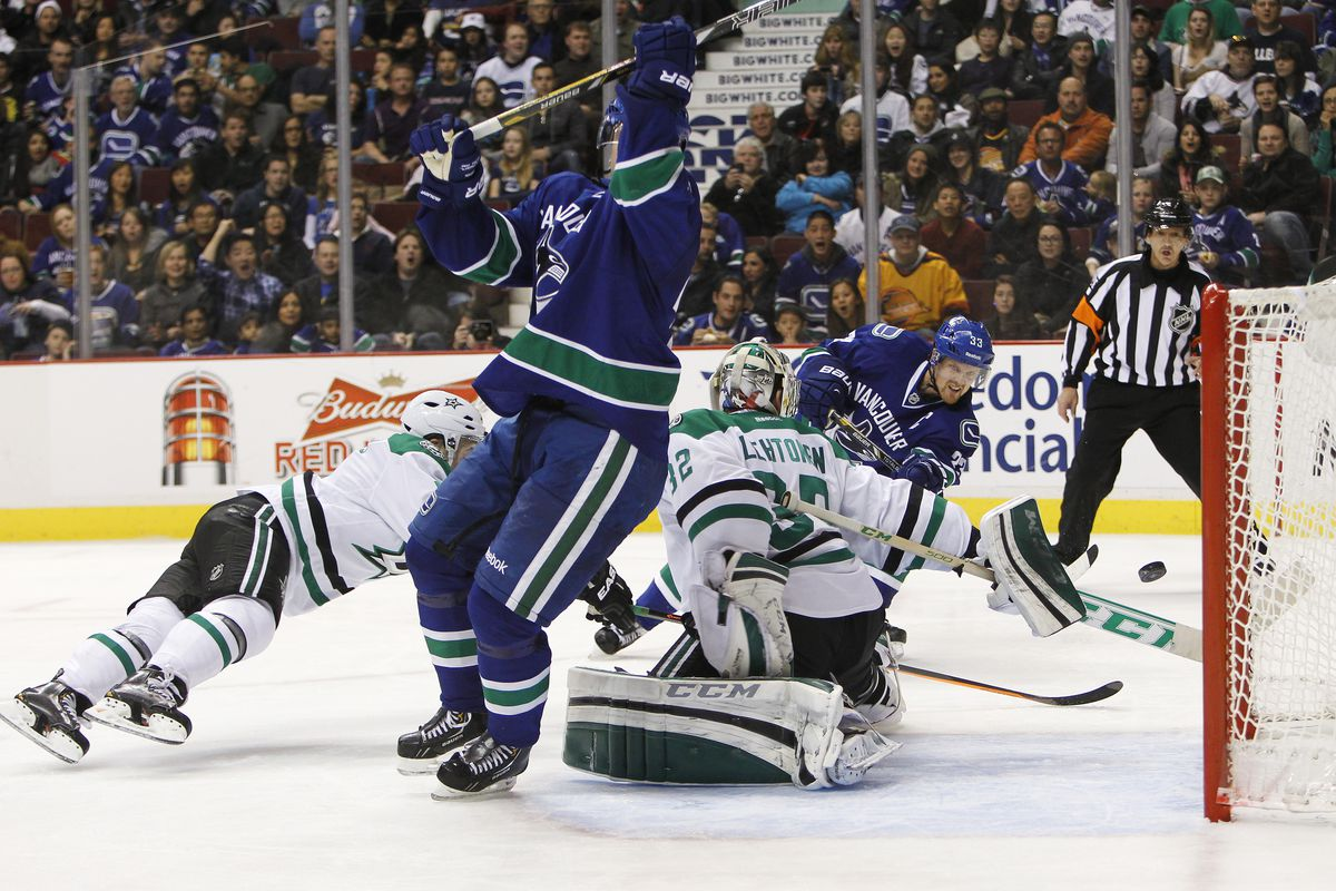 Kari Lehtonen very nearly got a stick on this shot by Henrik Sedin - could he have actually made the save without the slight bump from Daniel Sedin?
