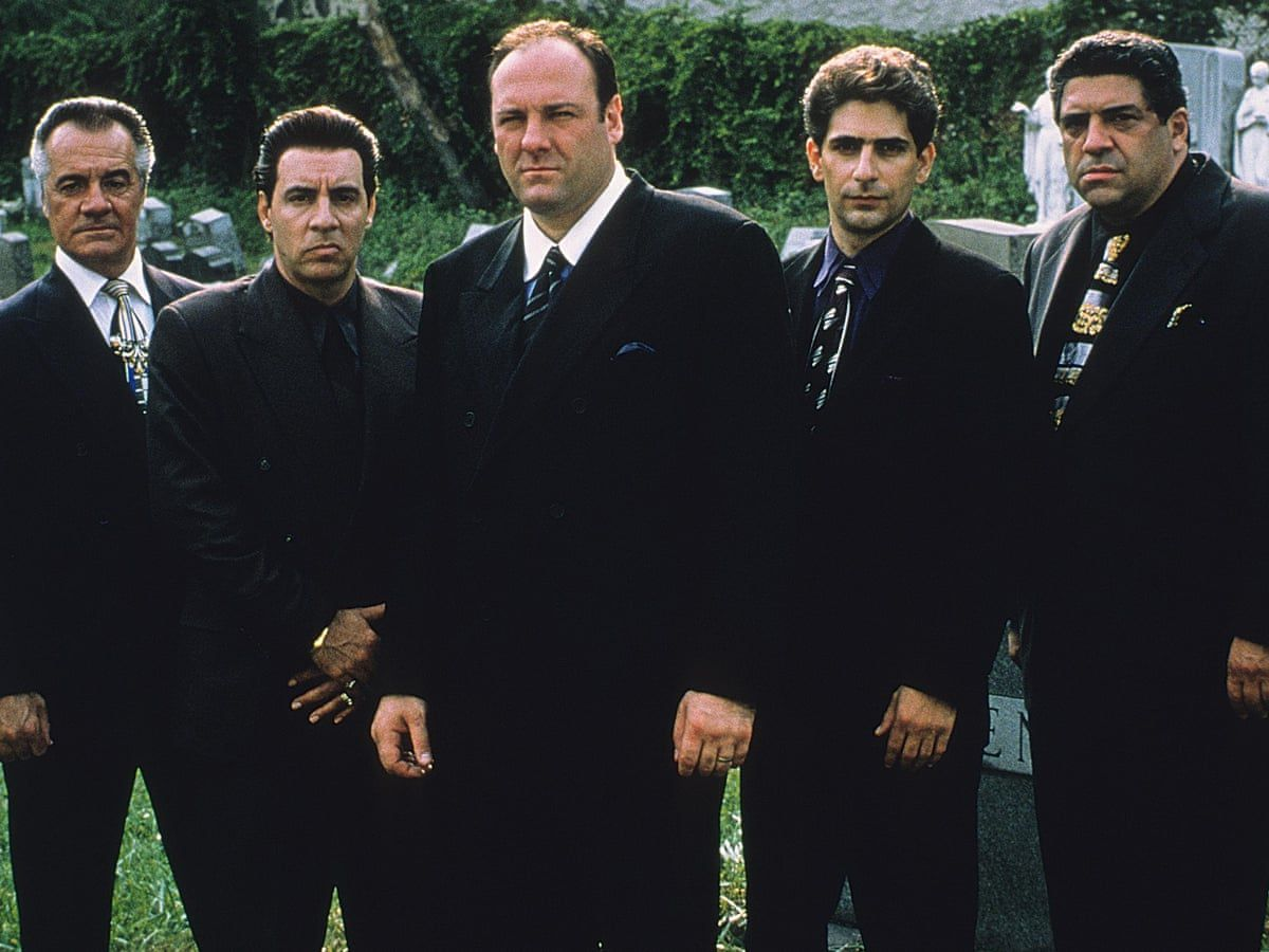 An image of Tony Soprano and his captains standing in a graveyard.