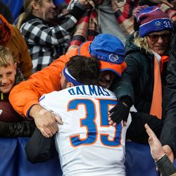 Boise State place-kicker Jonah Dalmas celebrates the victory against BYU with fans at LaVell Edwards Stadium in Provo on Saturday, Oct. 9, 2021.