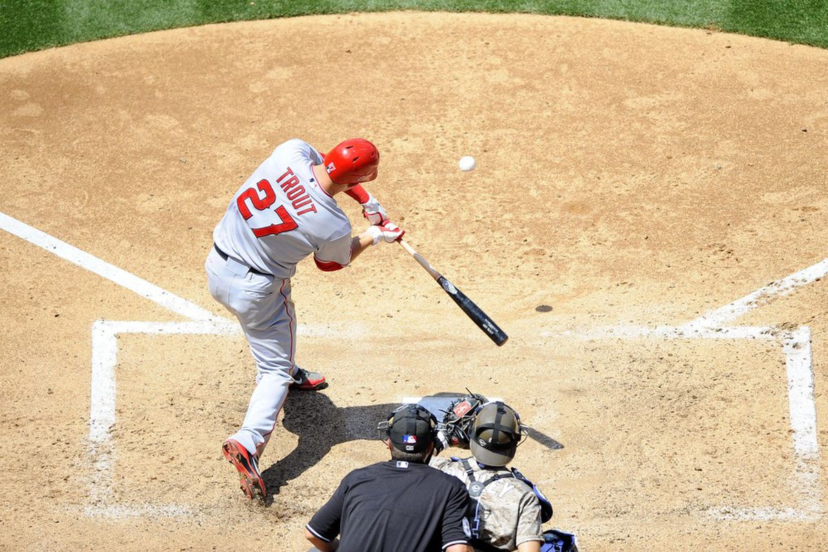 San Diego, CA, USA; Los Angeles Angels center fielder Mike Trout (27) hits a solo homerun during the fifth inning against the San Diego Padres at Petco Park.  Mandatory Credit: Christopher Hanewinckel-US PRESSWIRE