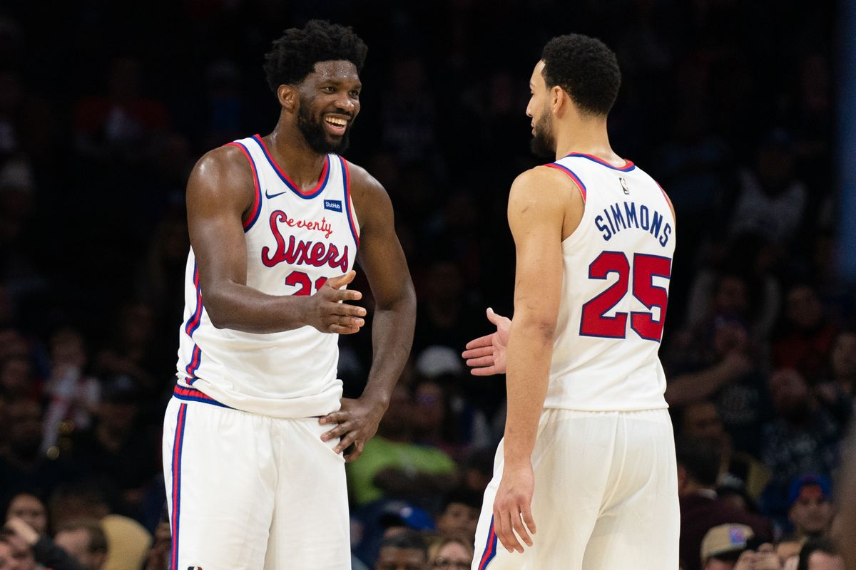 Philadelphia 76ers guard Ben Simmons and center Joel Embiid slap hands during the fourth quarter of a game against the New Orleans Pelicans at Wells Fargo Center.