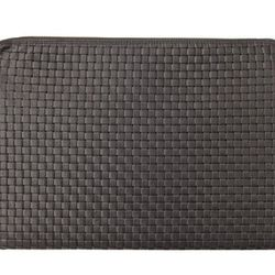 """Clare V. laptop case, <a href=""""http://www.clarev.com/collections/cases/products/laptop-zipcase-15#Black-Basketweave-Laptop-Zip-Case""""target=""""_blank"""">$186</a>."""