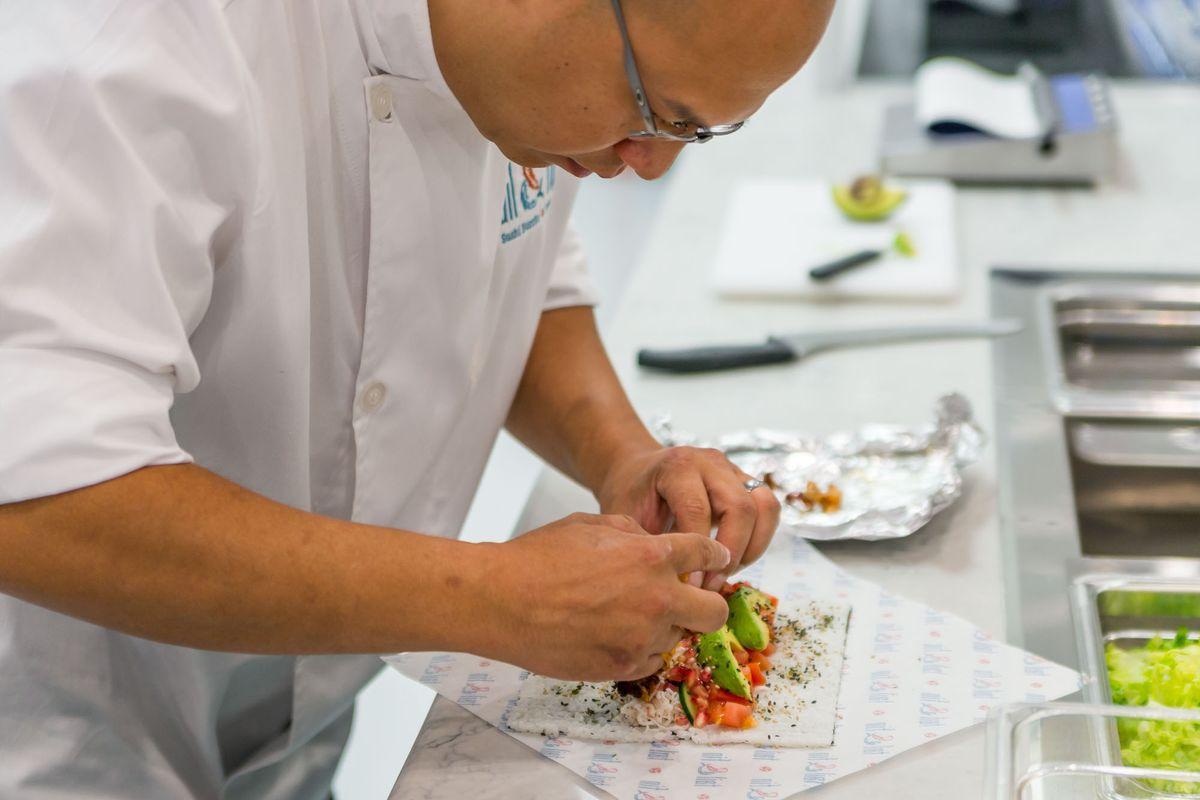 Chef Karu Wedhas rolls a sushi burrito in Vegas
