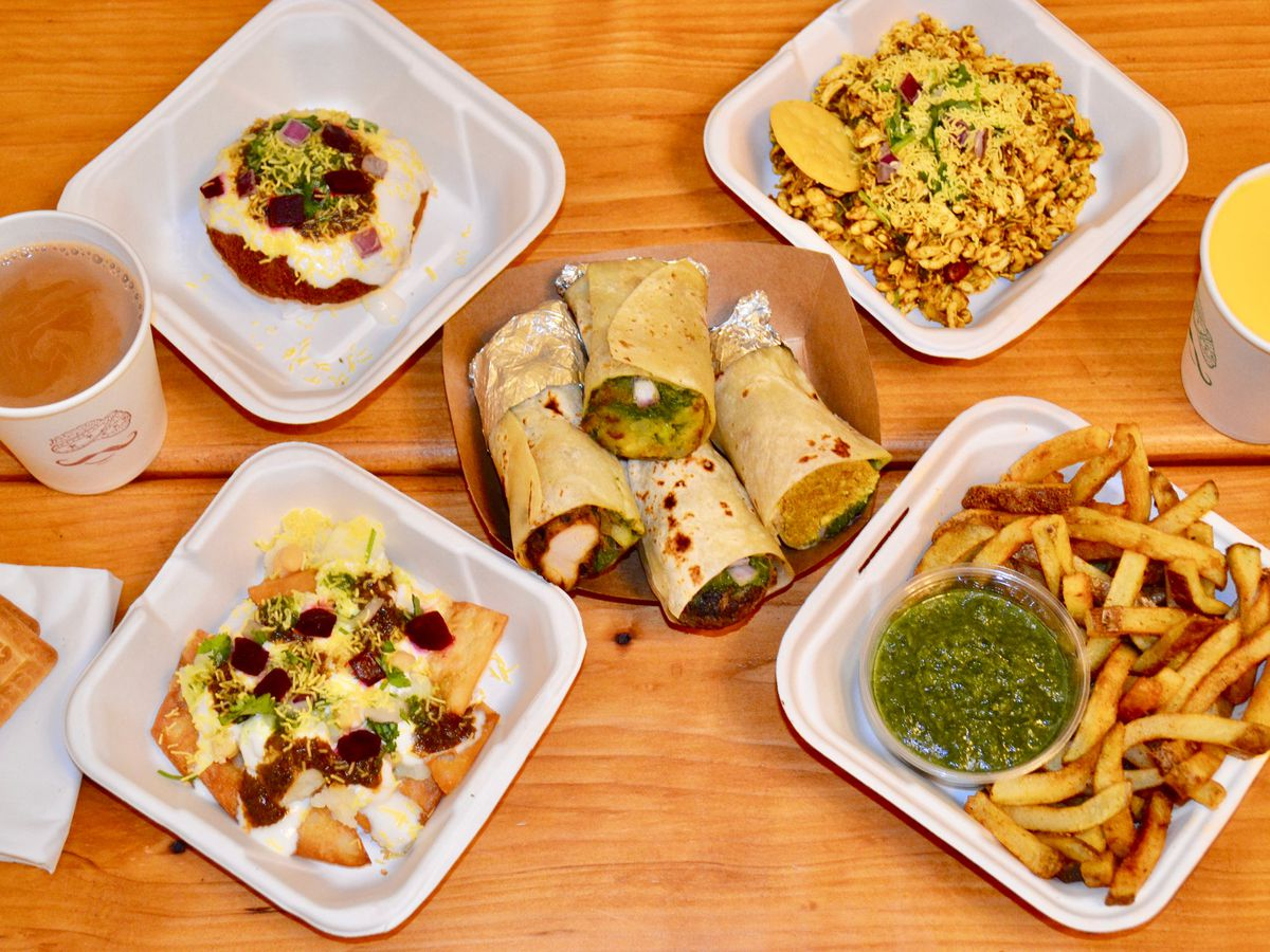 A collection of dishes from Spice Waala in Seattle