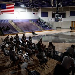 Syracuse players sit at their bench after power went out at the start of the girls basketball game between Riverton and Syracuse at Riverton High School on Tuesday, Dec. 15, 2020.