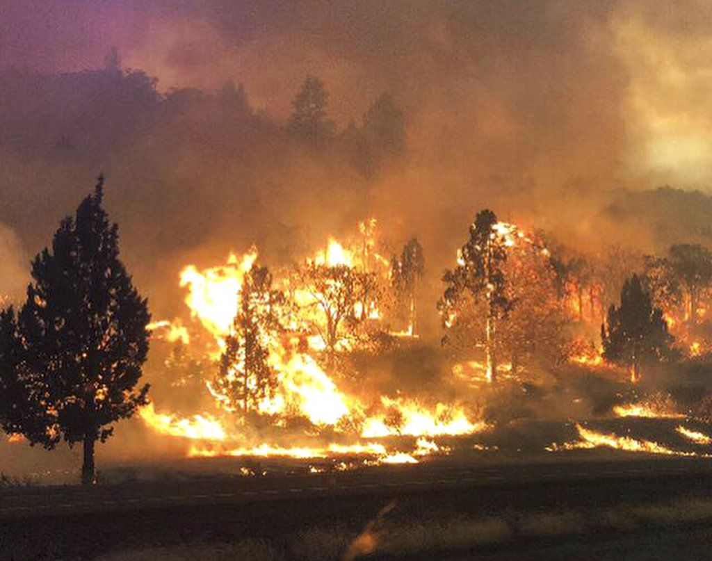 A local California official says a deadly blaze burning near the Oregon border moved swiftly through the rural area that is home to many retirees.   California Highway Patrol via AP