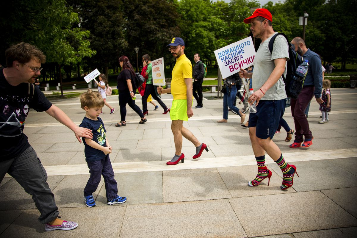 """May 5: Men wore high-heeled shoes and walked in the center of Sofia, Bulgaria, in order to show solidarity with women and the struggles they face during the """"Walk a Mile in Her Shoes"""" campaign to draw attention to the violence against women. (Jodi Hilton/"""