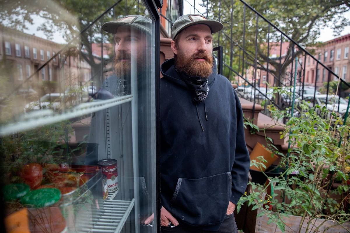 Anarchist Thadeaus Umpster restocks a free food fridge outside his Bed-Stuy, Brooklyn home, Sept. 24, 20200.