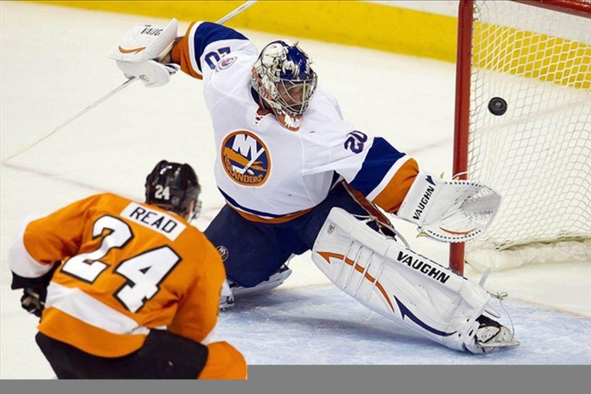 Mar 1, 2012; Philadelphia, PA, USA;  Philadelphia Flyers right wing Matt Read (24) scores against New York Islanders goalie Evgeni Nabokov (20) during the 2nd period at the Wells Fargo Center.  Mandatory Credit: Christopher Szagola-US PRESSWIRE