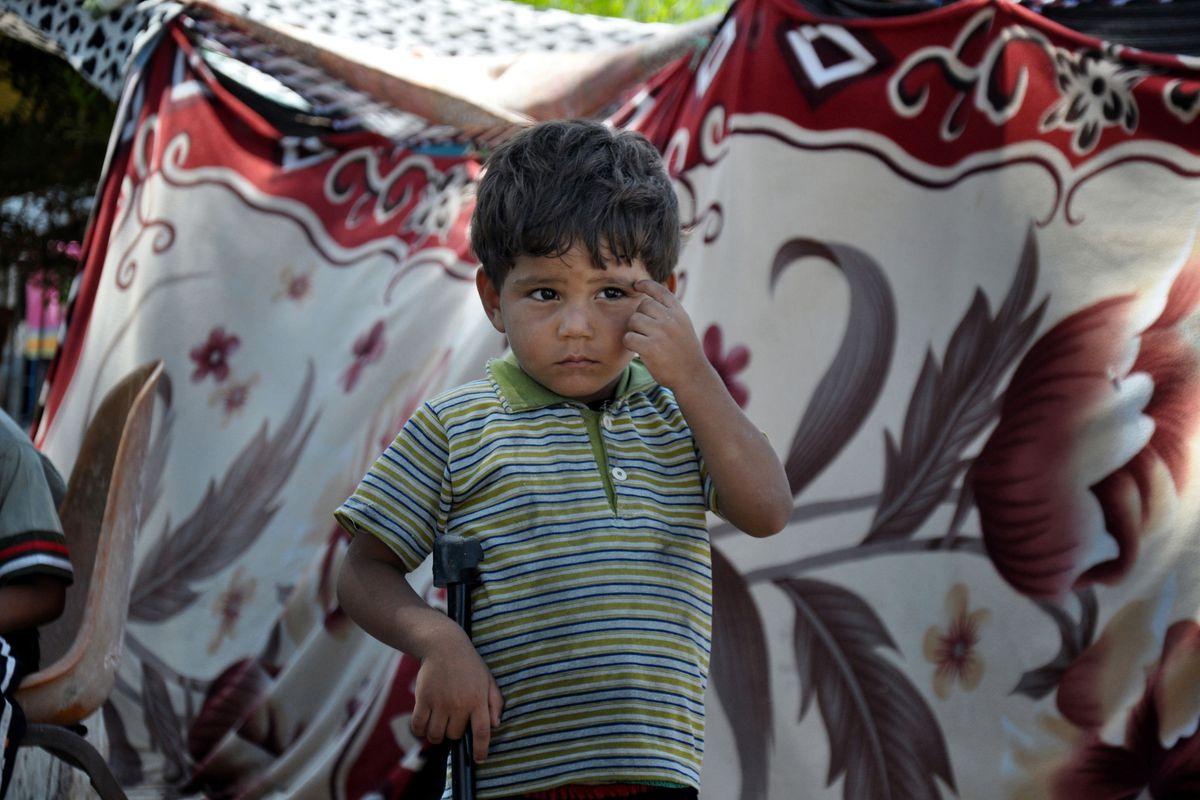 A Palestinian boy near Gaza's Al-Shifa hospital.