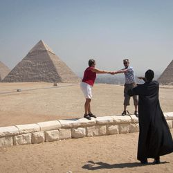 In this Thursday, Sept. 27, 2012 photo, foreign tourists visit the historical site of the Giza Pyramids, near Cairo, Egypt. The Egyptian demonstrations against an online film that was produced by a U.S. citizen originally from Egypt and denigrates the Prophet Muhammad were part of a wider explosion of anger in Muslim countries. They happened near the U.S. Embassy, far from the pyramids of Giza on Cairo's outskirts, and a lot further from gated Red Sea resorts, cocoons for the beach-bound vacationer. Yet the online or TV images _ flames, barricades, whooping demonstrators _ are a killjoy for anyone planning a getaway, even though the protests have largely subsided. Tour guides in Egypt say tourist bookings are mostly holding, but they worry about a dropoff early next year, since people tend to plan several months ahead.