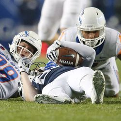 Brigham Young Cougars tight end Matt Bushman (89) is upended by Boise State players in Provo on Friday, Oct. 6, 2017.