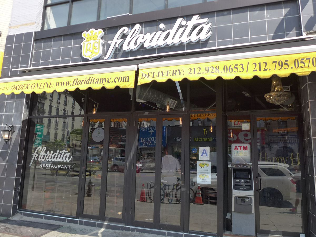 A black facade with a coat of arms and Floridita in cursive.